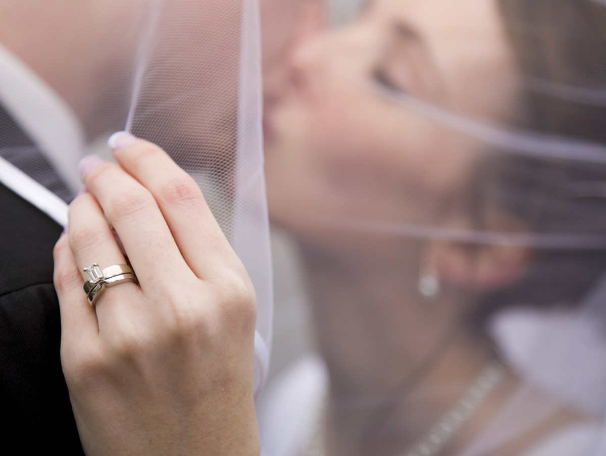closeup of a bride kissing her new husband
