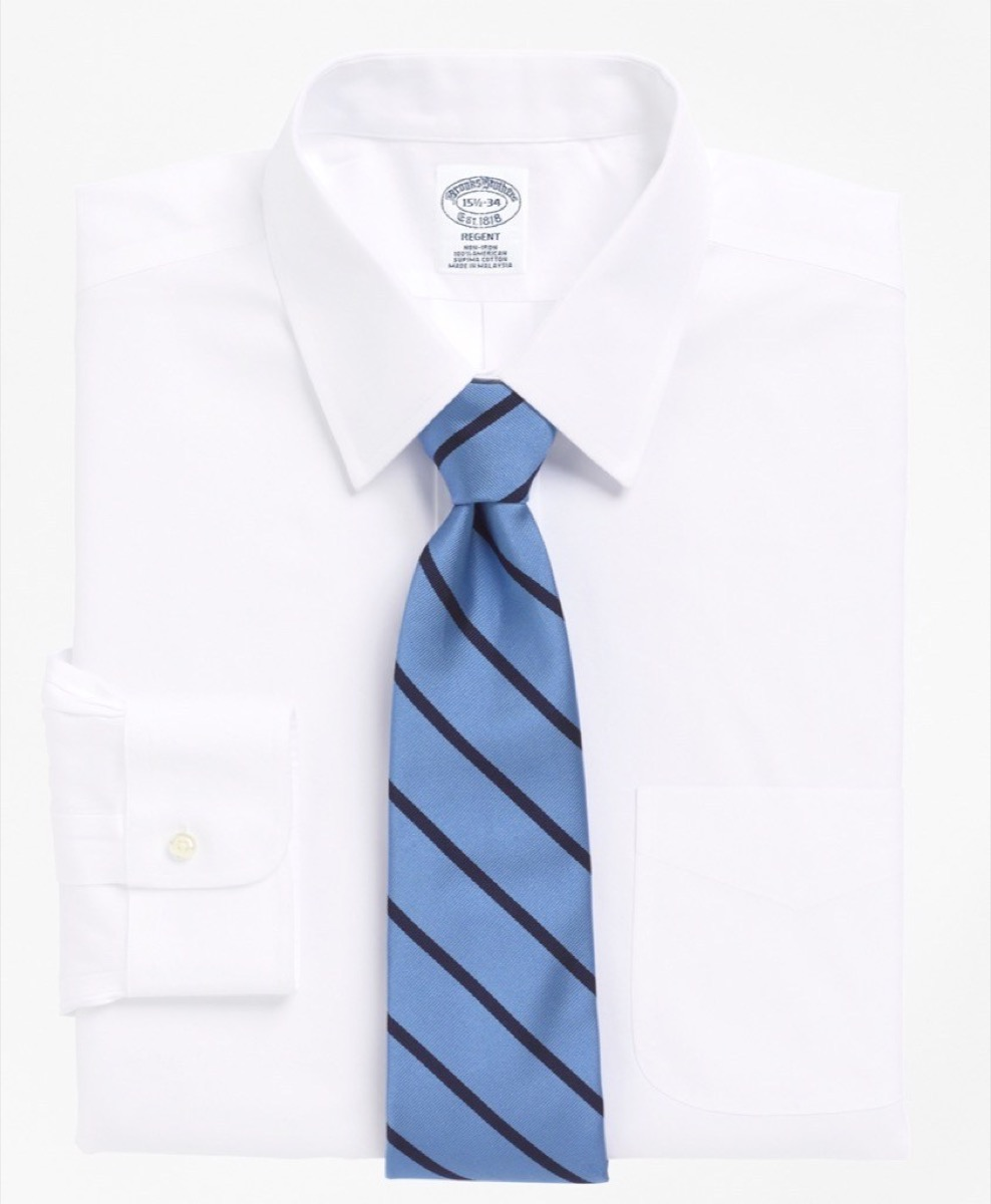 white button down shirt and blue striped tie