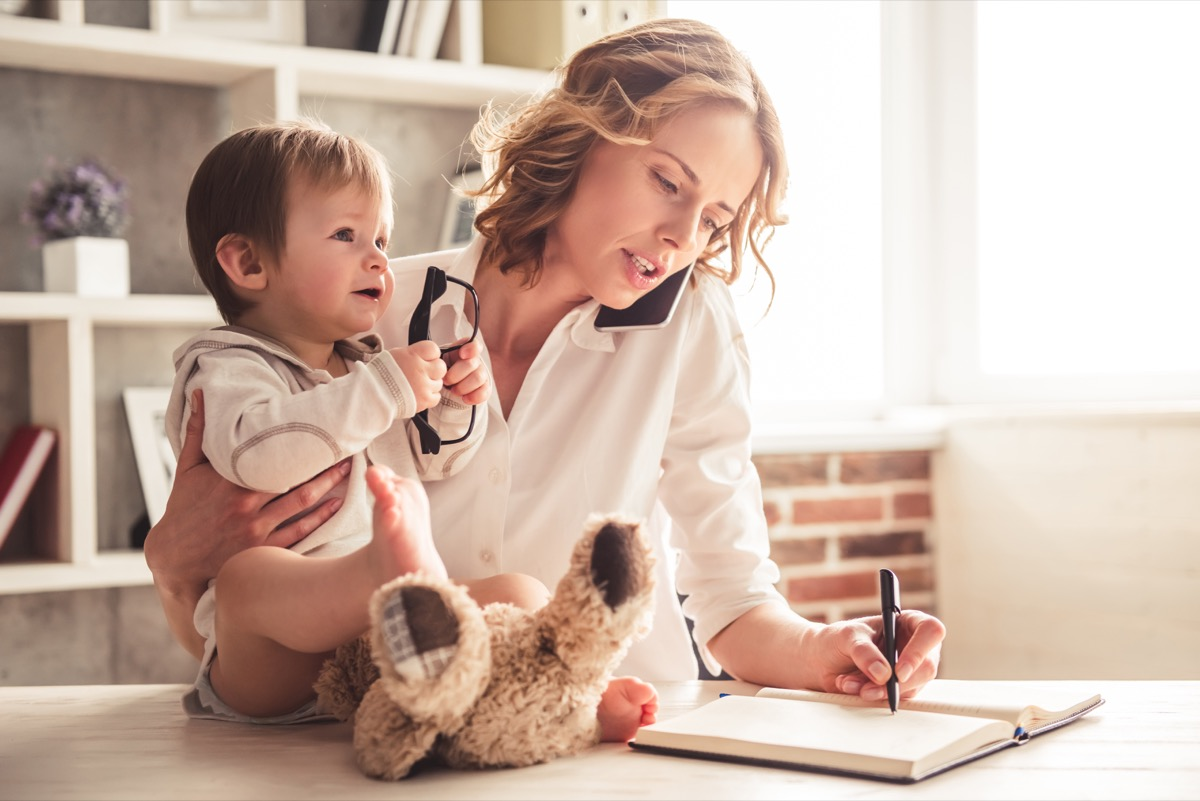 Busy mom on the phone, doing work, and with baby
