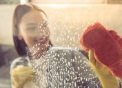Woman cleaning a shower