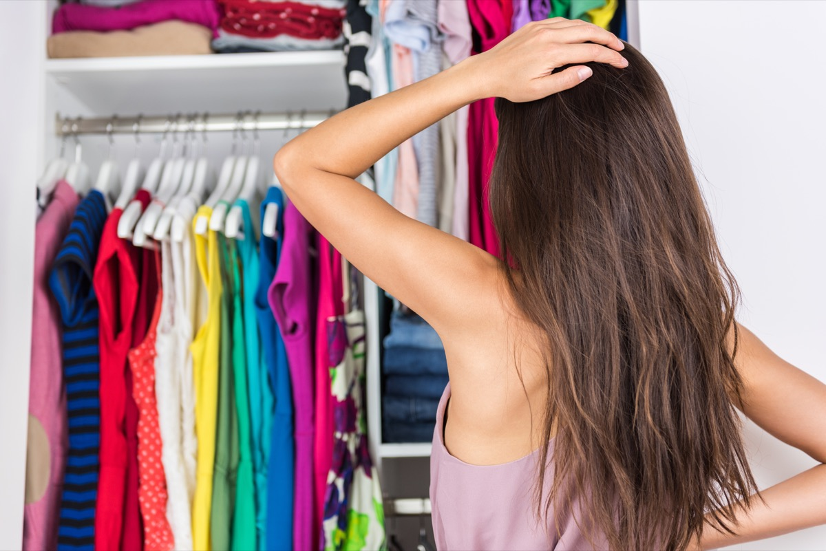 Woman looking at her closet
