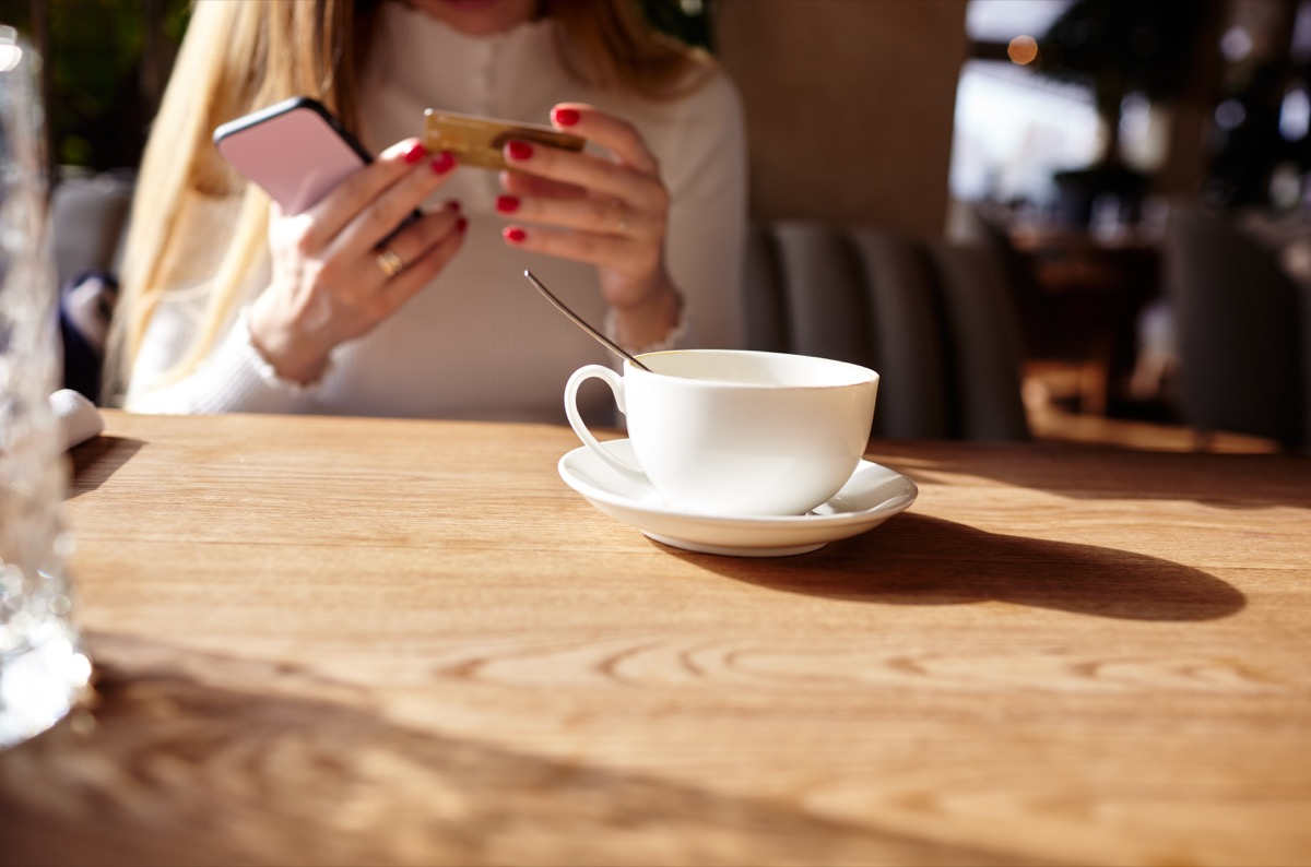 Woman in a cafe with a cup of coffee