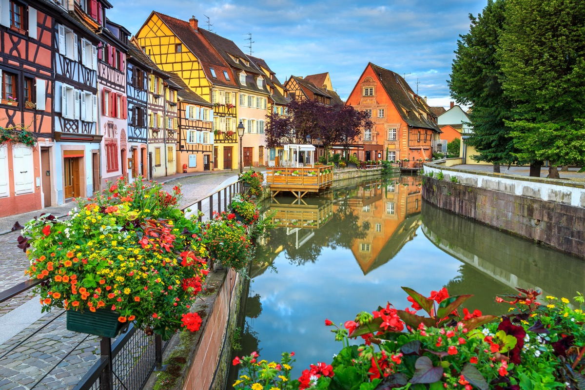 Spectacular colorful traditional french houses on the side of river Lauch in Petite Venise