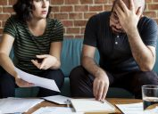 couple looking at paperwork with fine