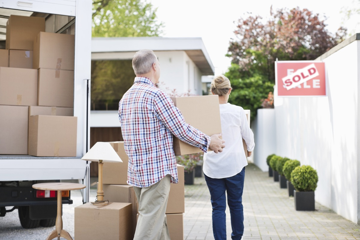 couple unloading their boxes when moving stuff out of a moving truck