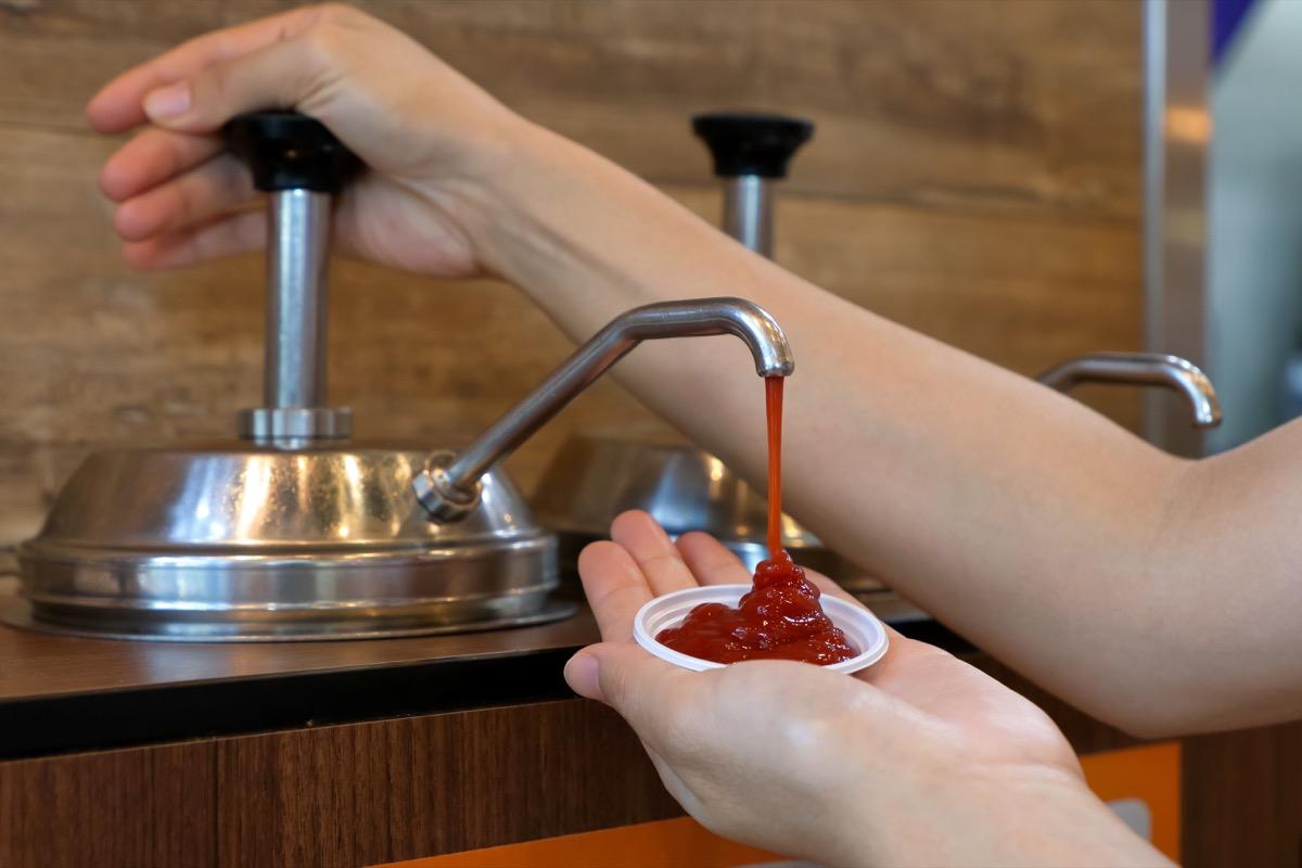 woman pumping ketchup
