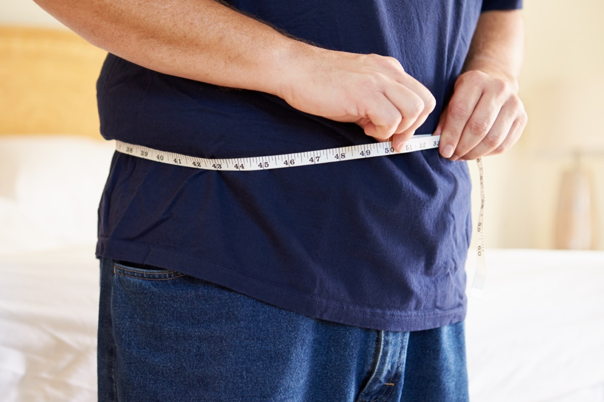 man checking his stomach size