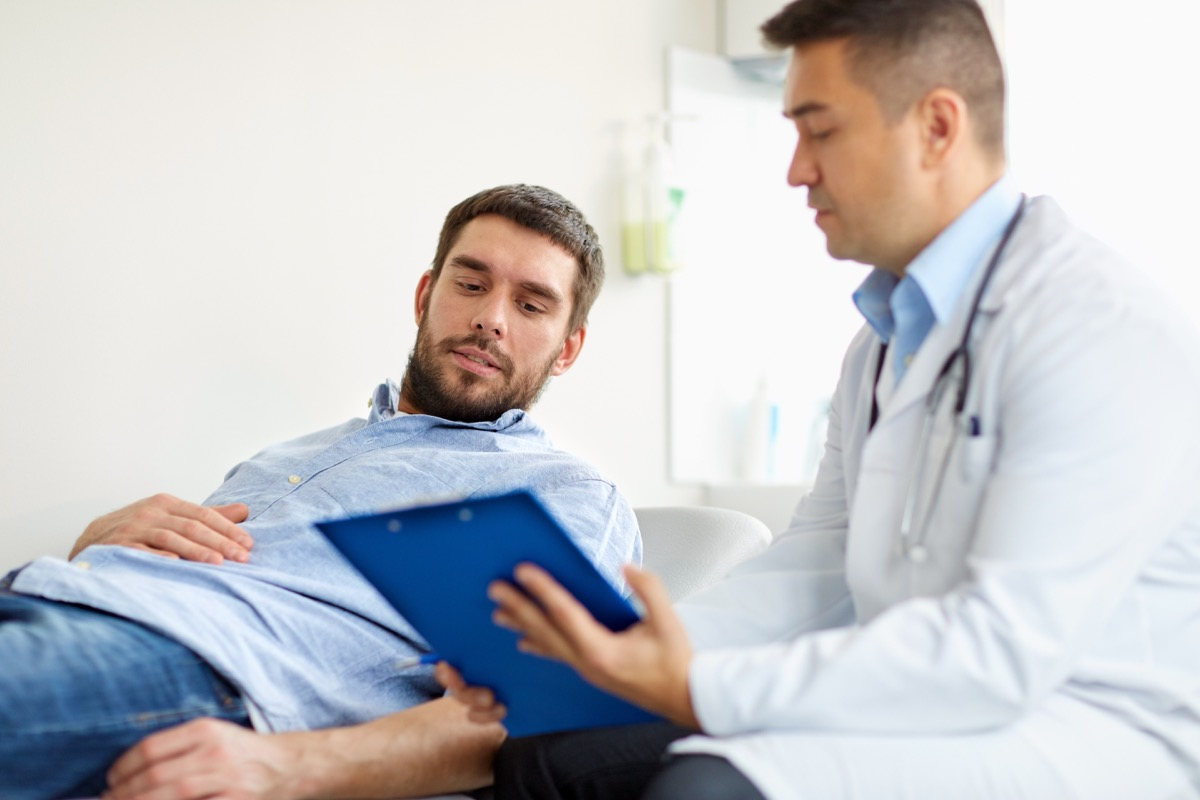 Man at doctor getting physical