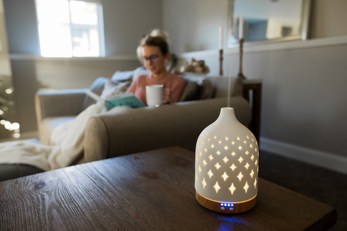 young white woman working from home with essential oil diffuser