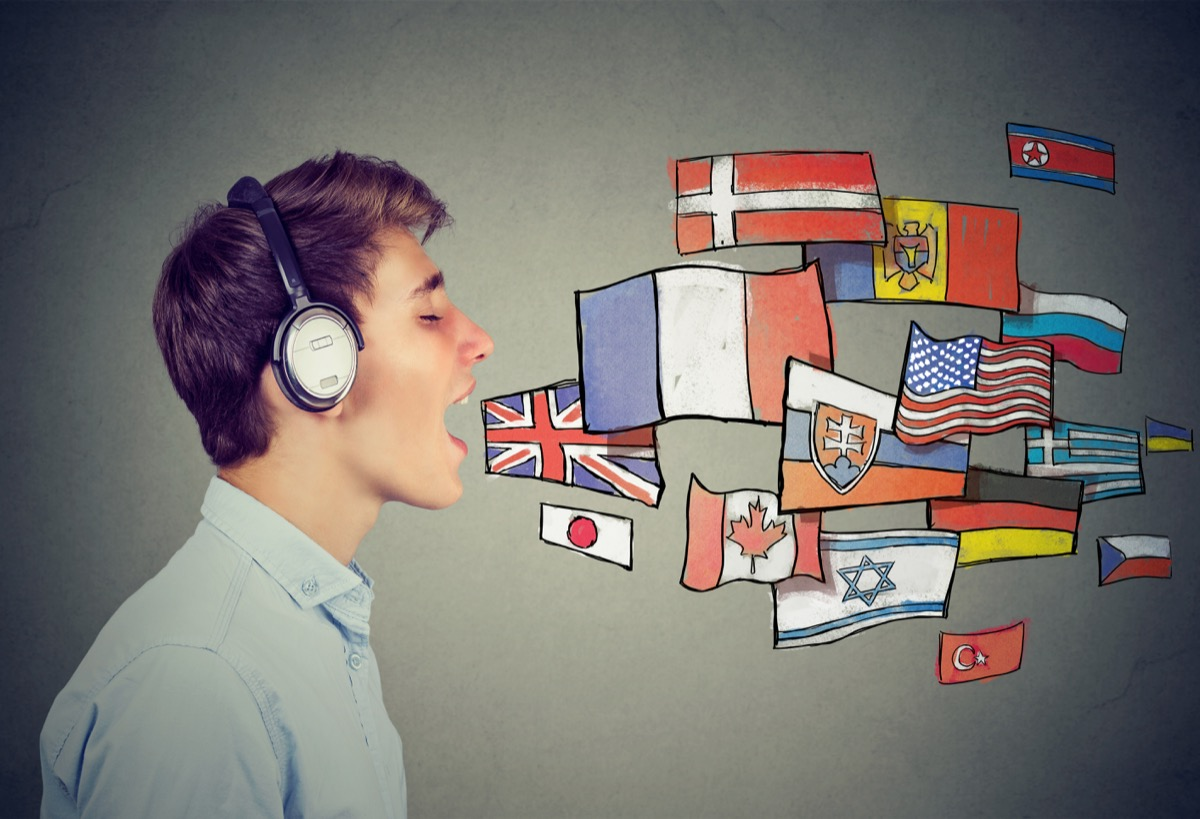 man speaking with flags of different countries