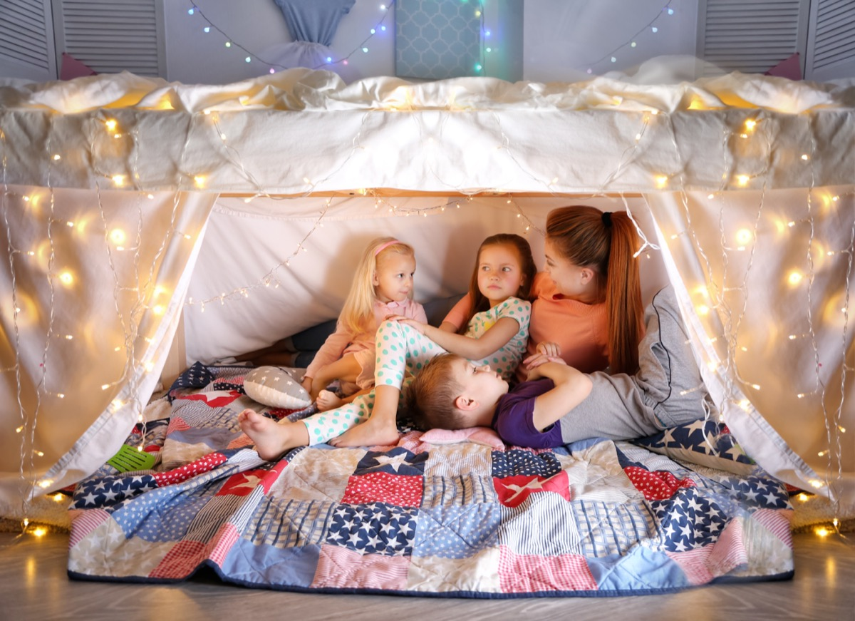 Kids in a fort with their mother