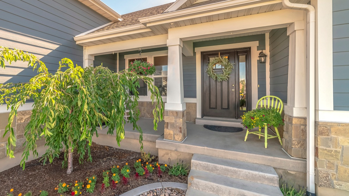 front porch with wreath and plants