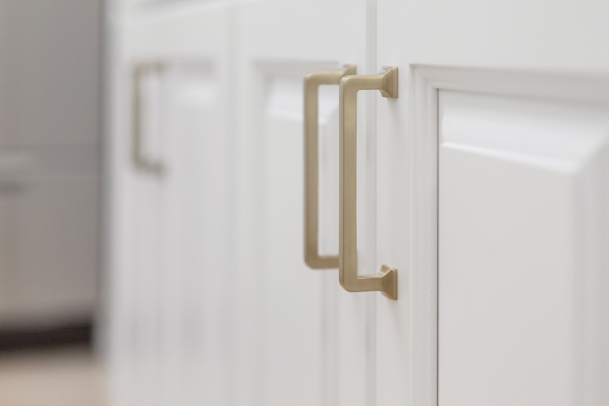 white cabinet with gold handles