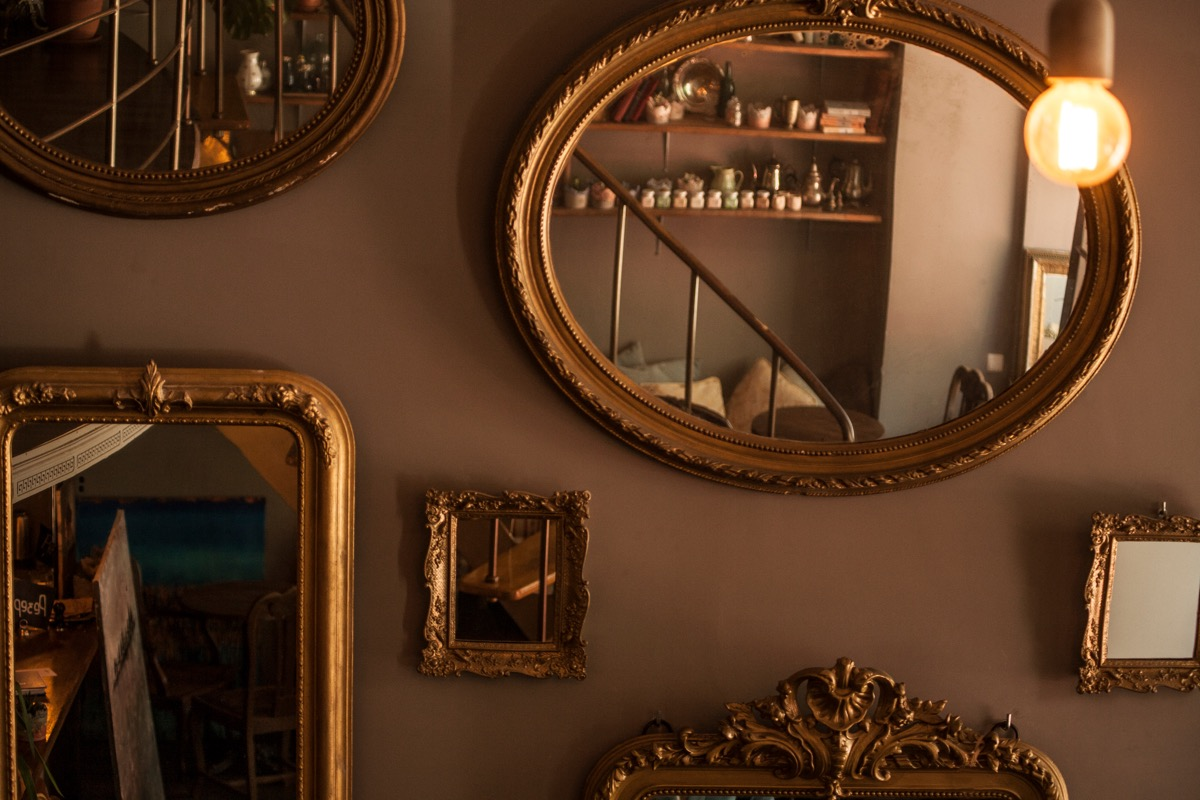 gallery wall of gold mirrors