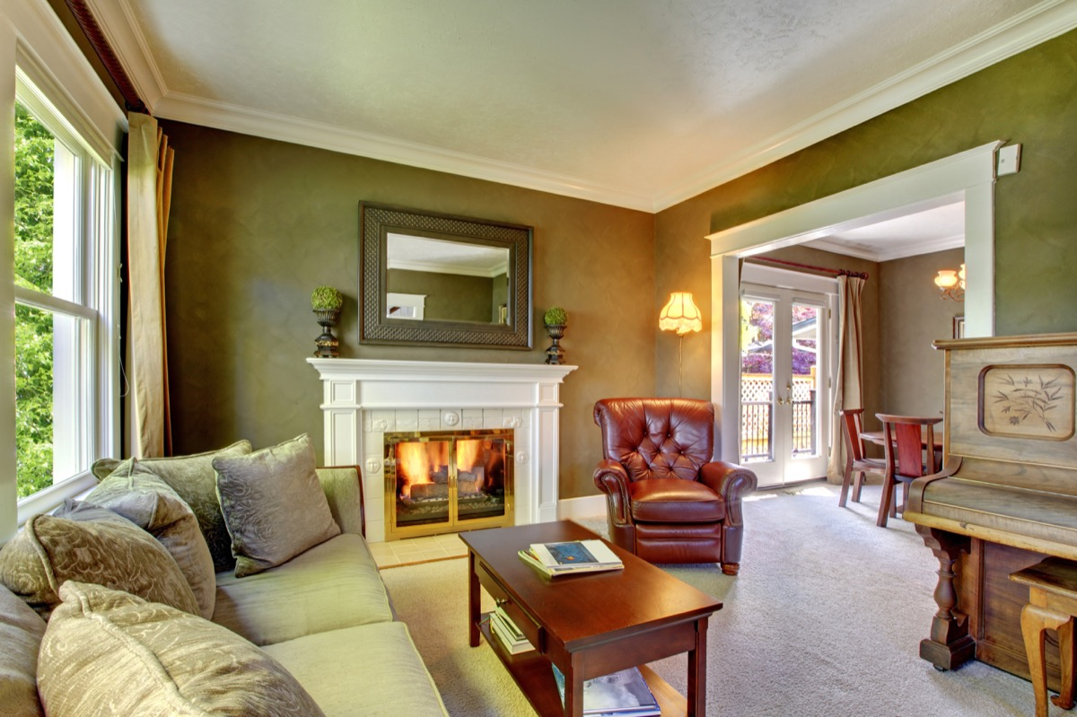 green wall with white moldings
