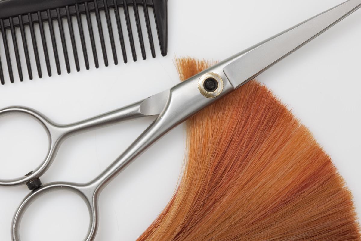hair scissors next to red hair