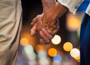 Couple holding hands at night