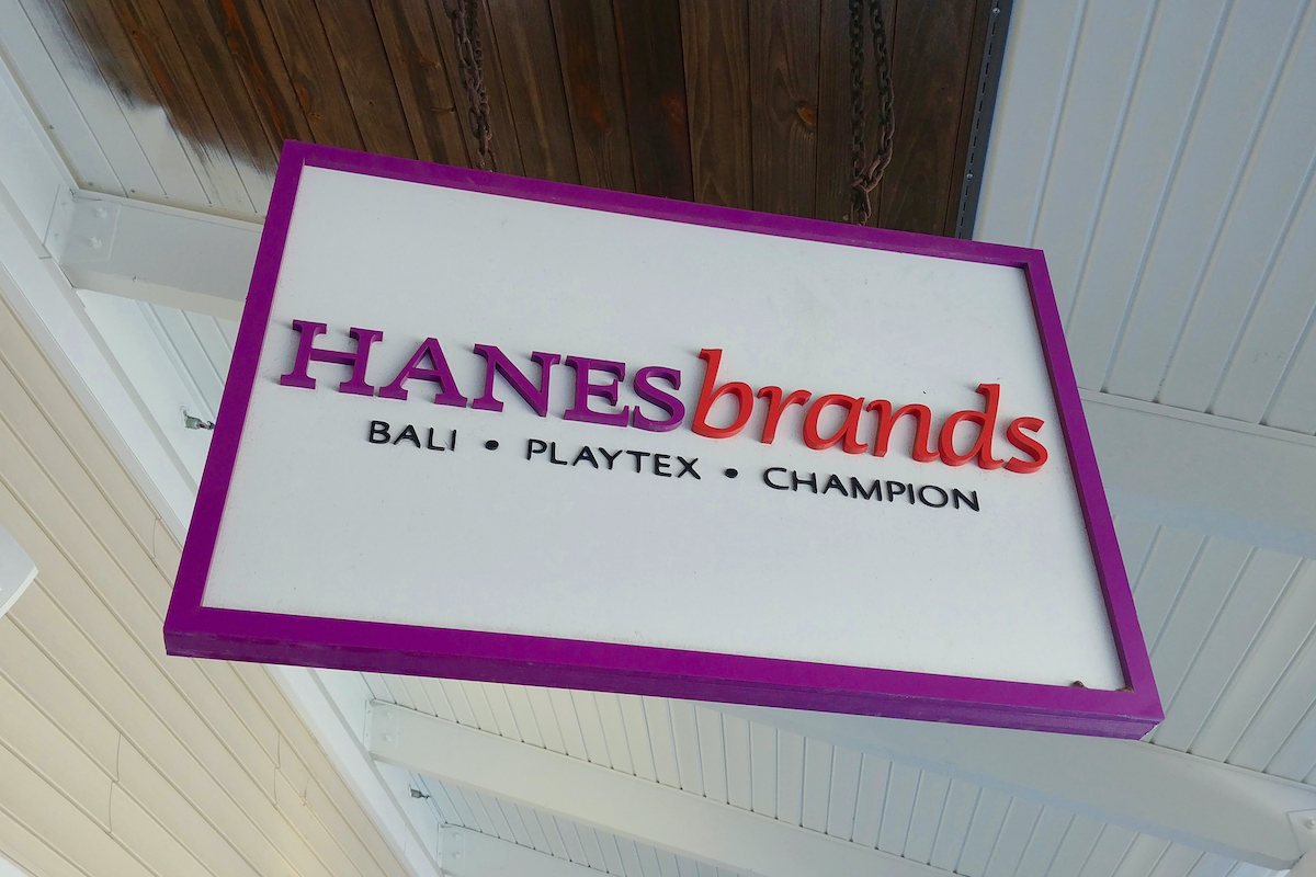 Sign for the Hanes Brands store at Wrentham Village Premium Outlets in Wrentham, Massachusetts