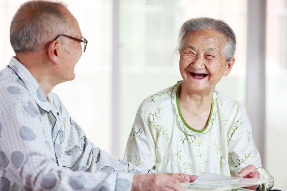 Older couple happy talking