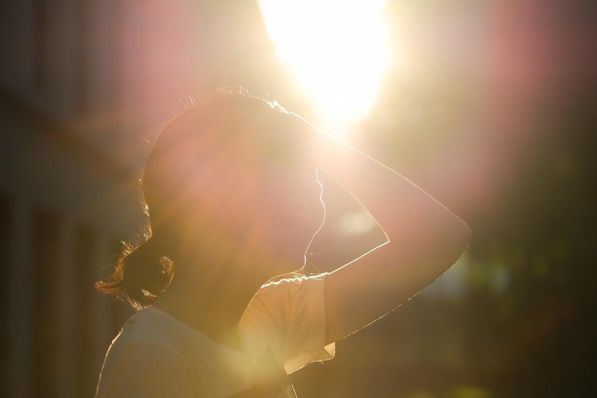 Woman in the hot sun