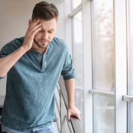 Man with headache hungover