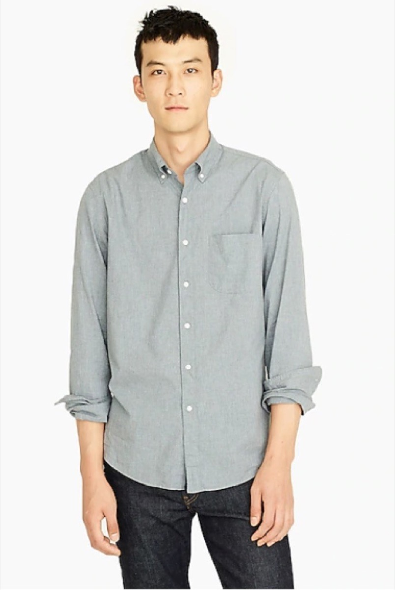 young asian man in gray button down