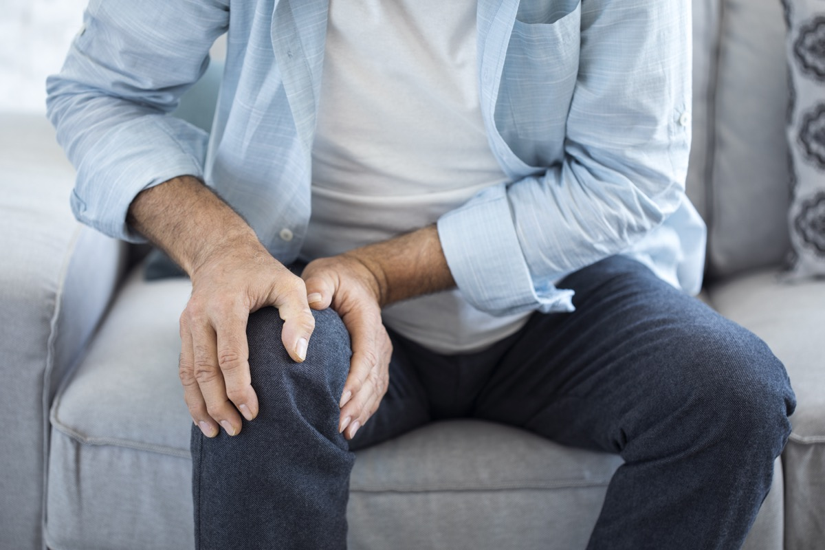 Man experiencing joint pain in his knee