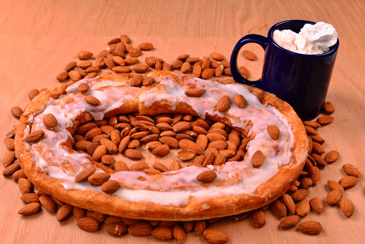 kringle pastry surrounded by almonds