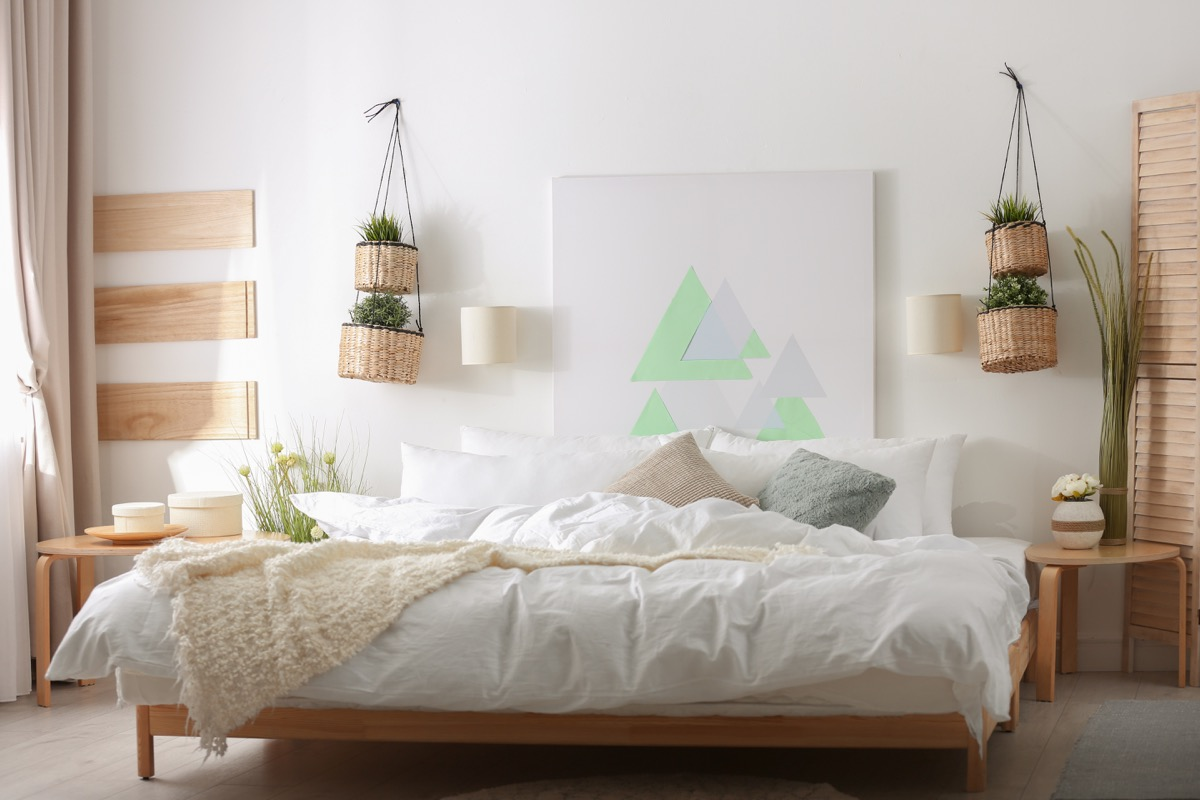large modern painting on bedroom wall