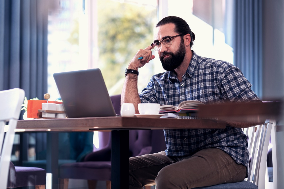 Man learning studying online