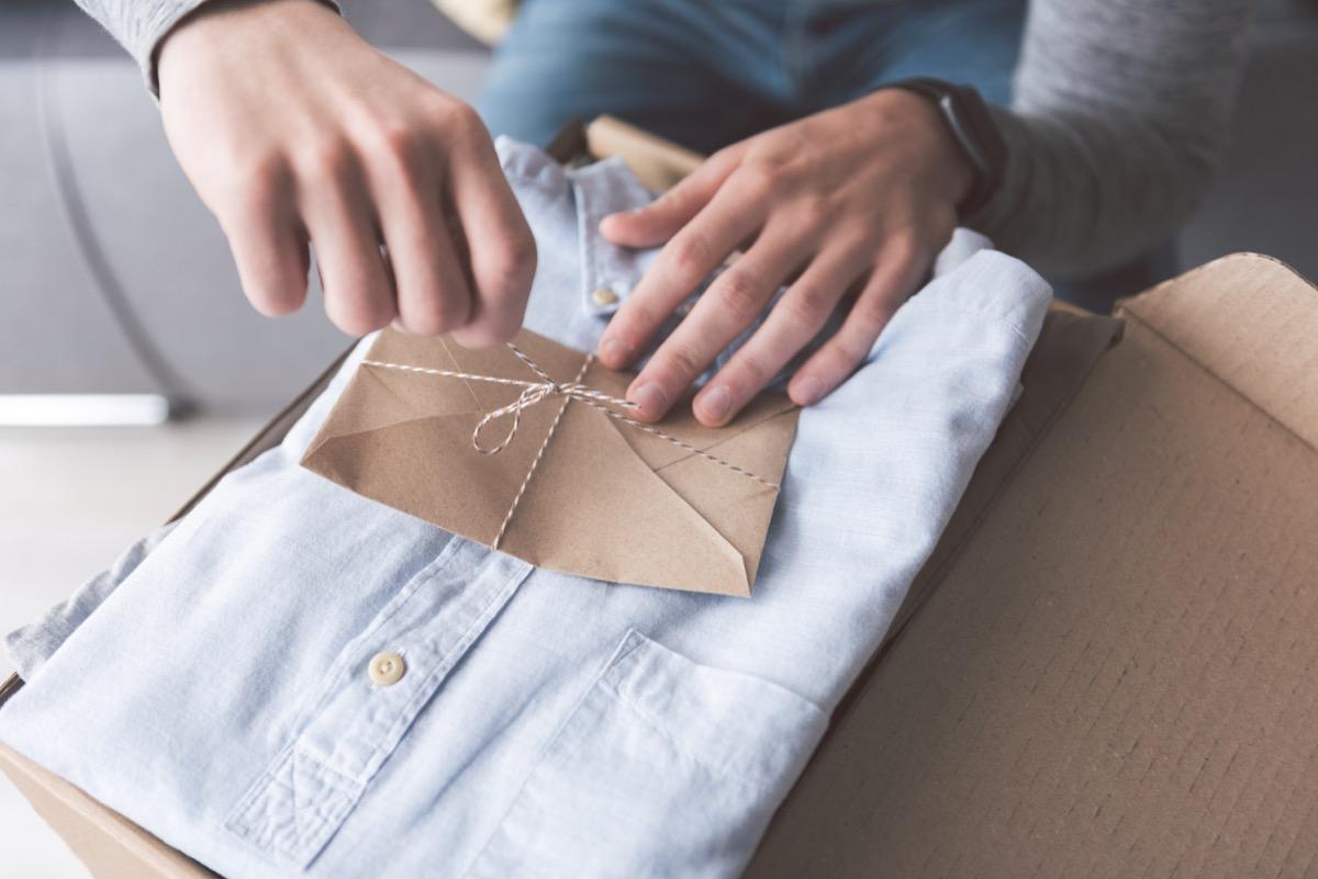 man opening shirt gift