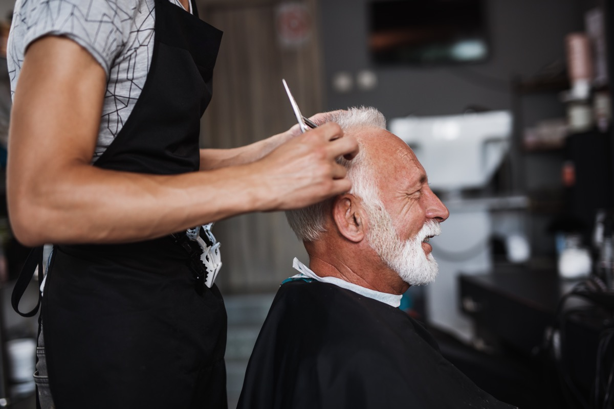 Senior good looking man at haircut in a hairdresser's salon.