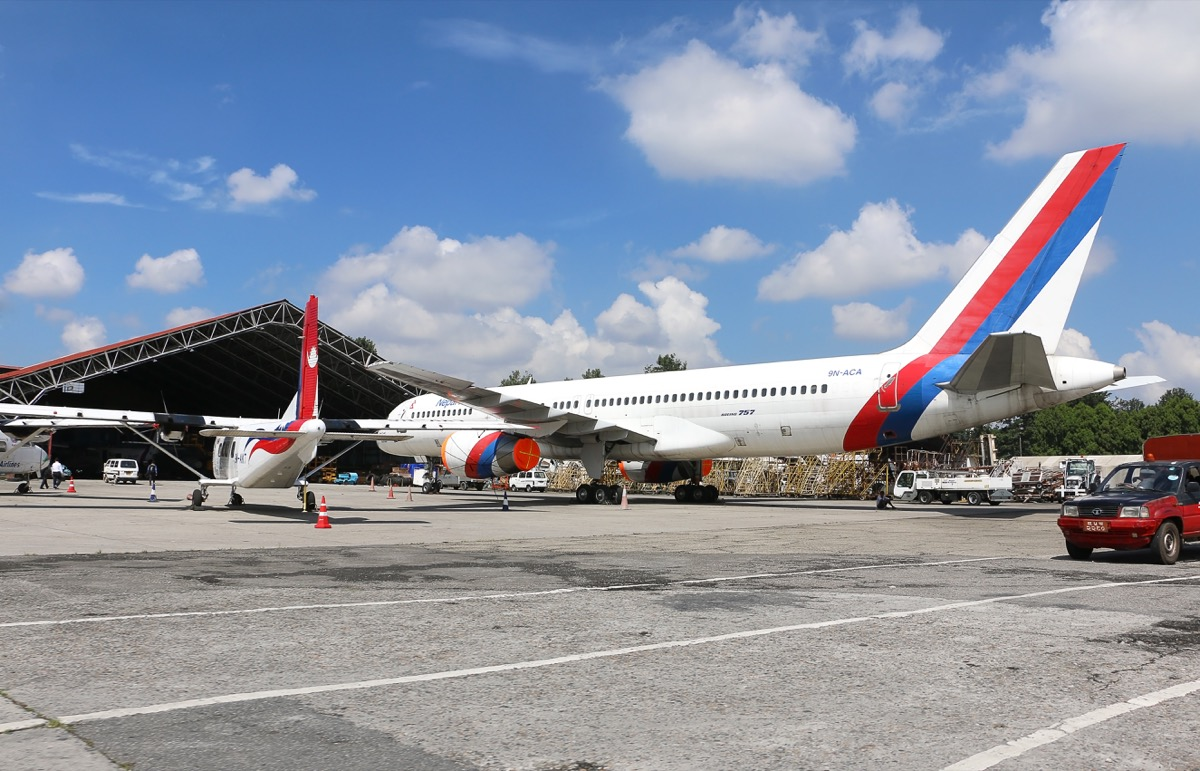 nepal airlines boarding passengers into the plane
