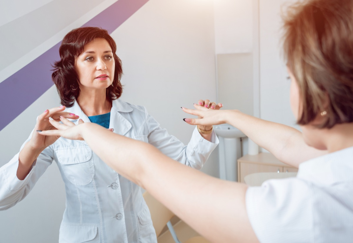 Neurologist testing patient's reflexes and nerves
