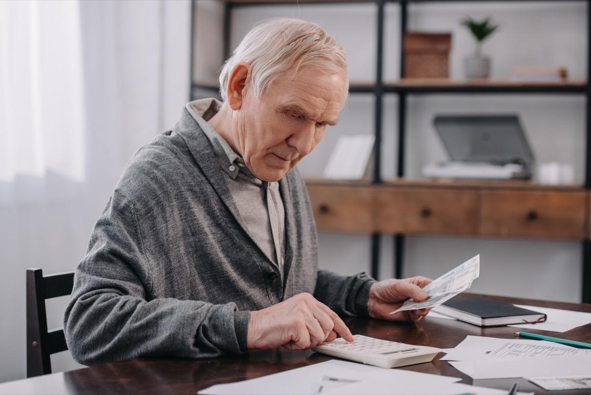 Older man calculating money