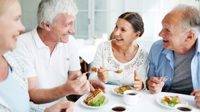 group of older white adults having lunch together