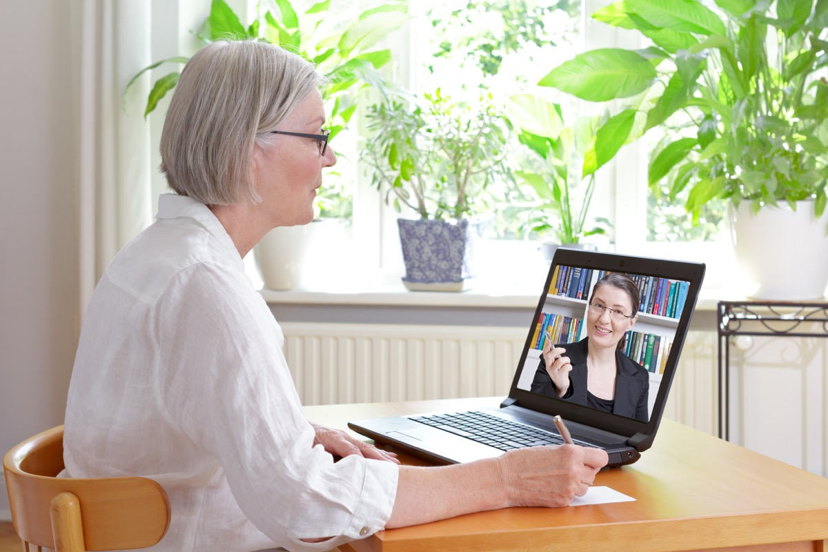 older white woman doing video therapy with middle aged female therapist