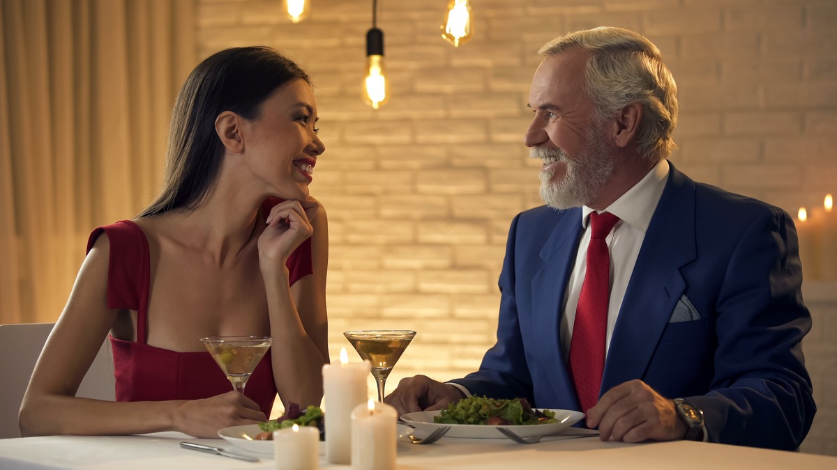 Older man on a date with a younger woman