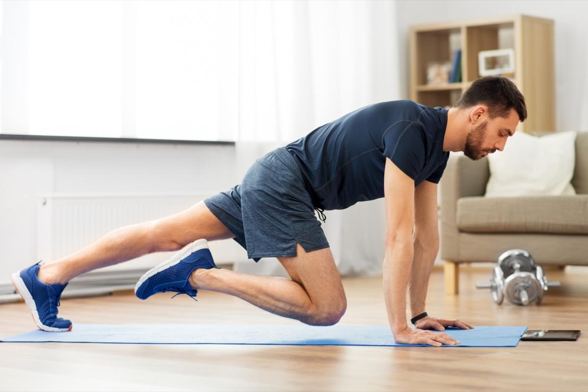 Man doing an at home online workout
