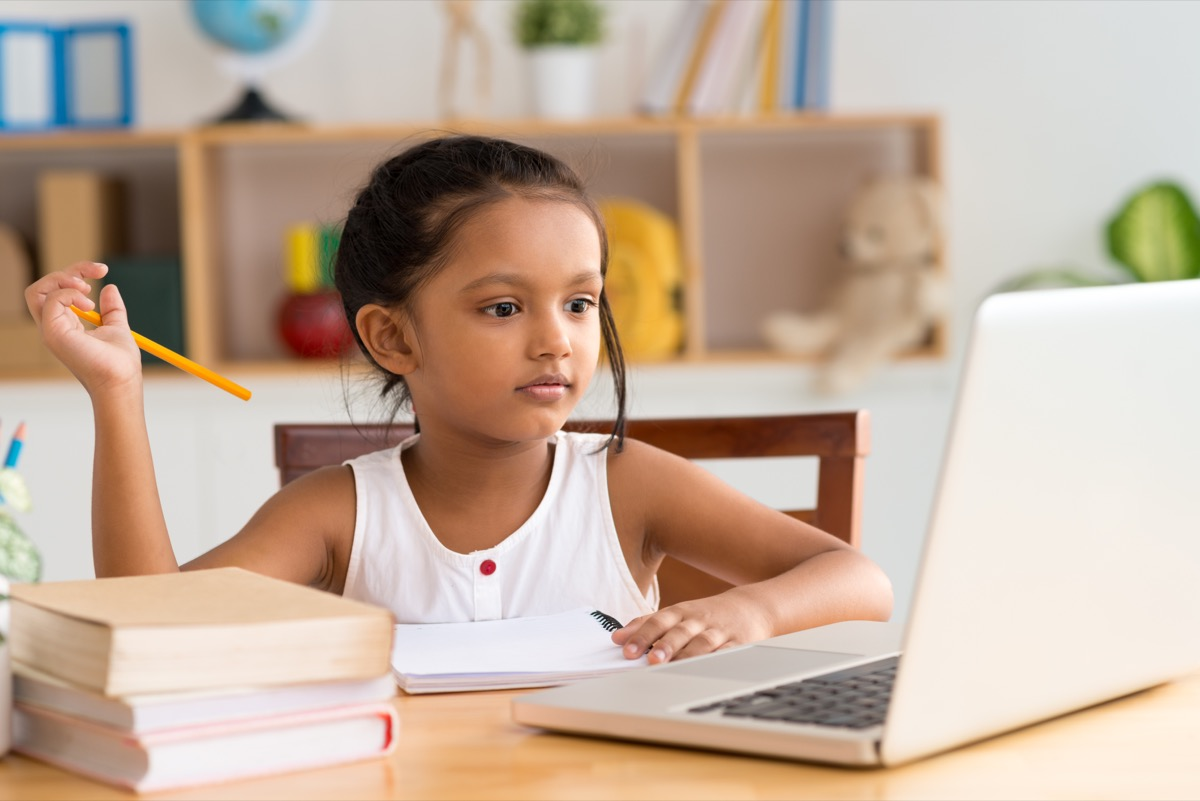 Young girl doing online work