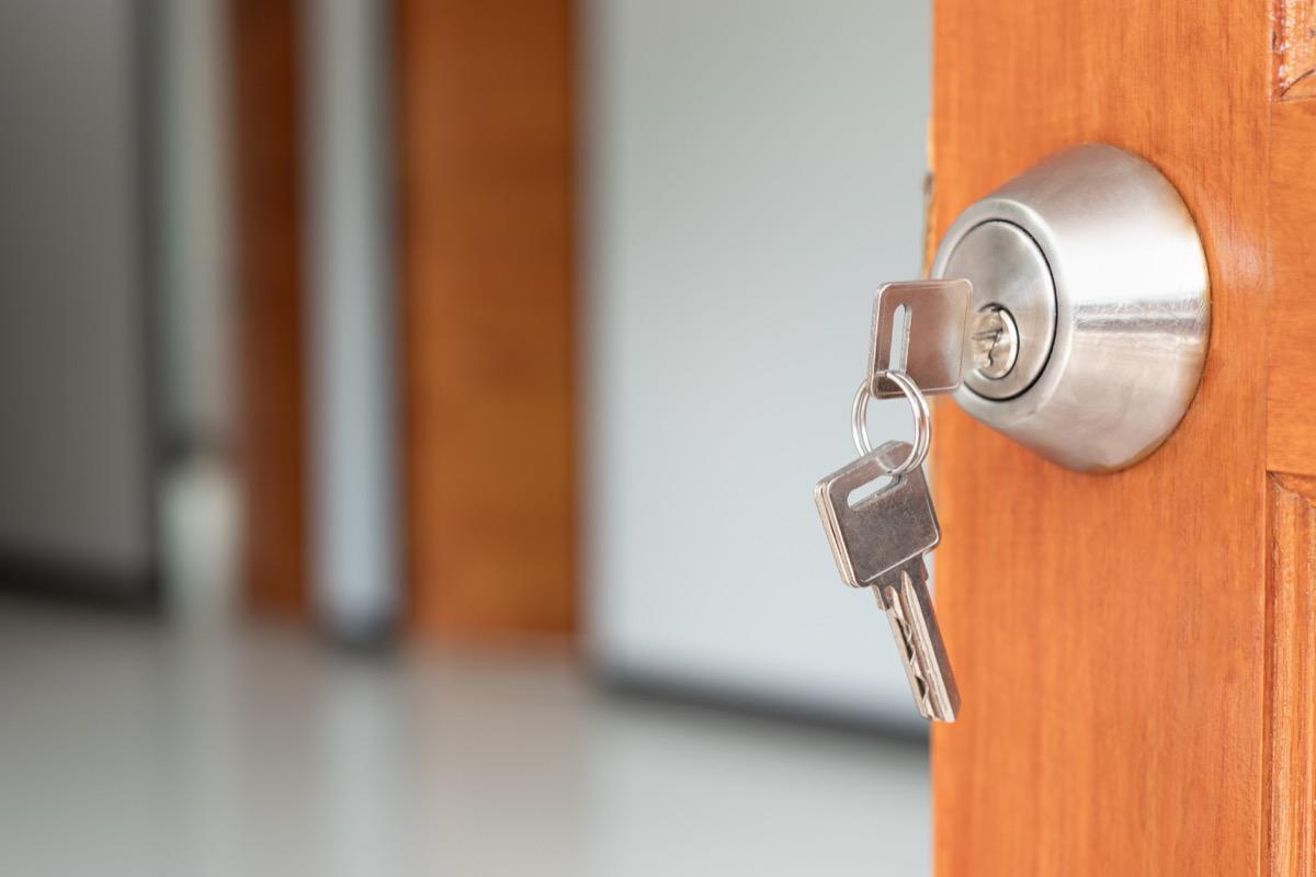 key in wood door opening front door concept