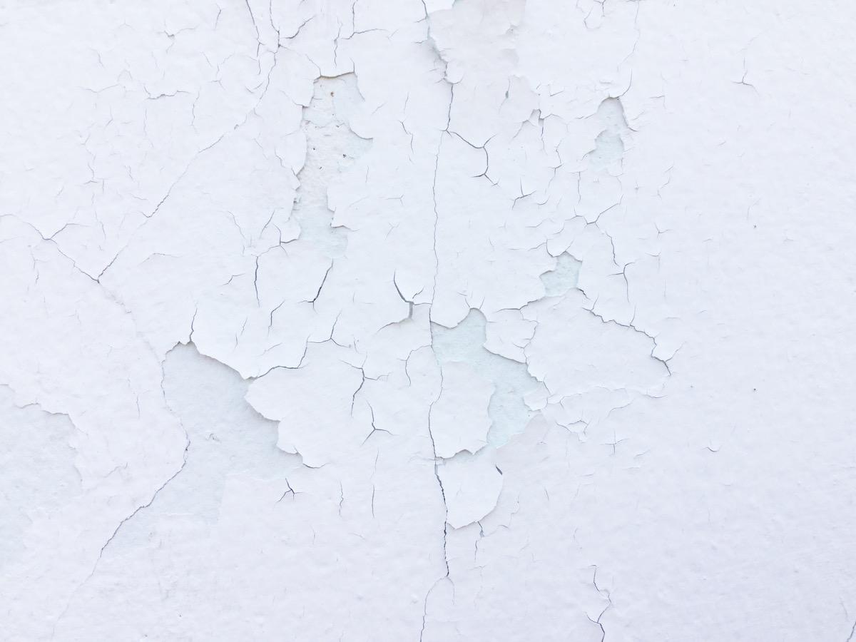 peeling white paint on wall