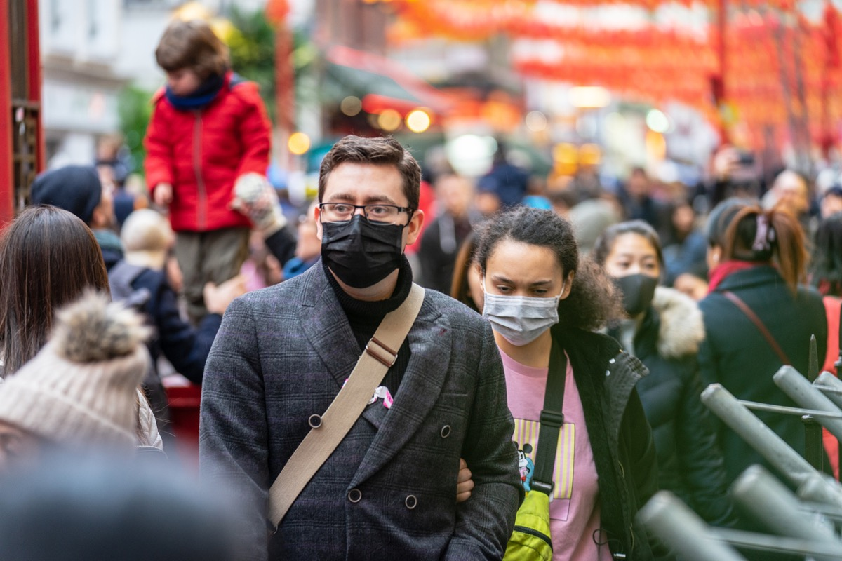 People in London wearing face masks to protect themselves against coronavirus