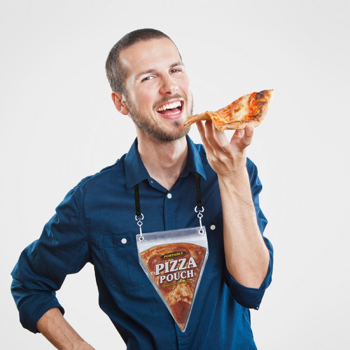 young white man holding pizza