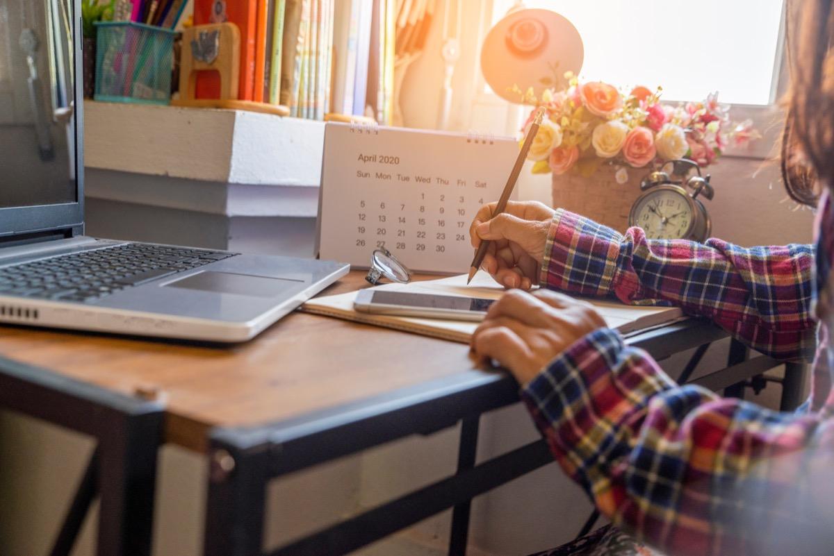 Girl writing in planner