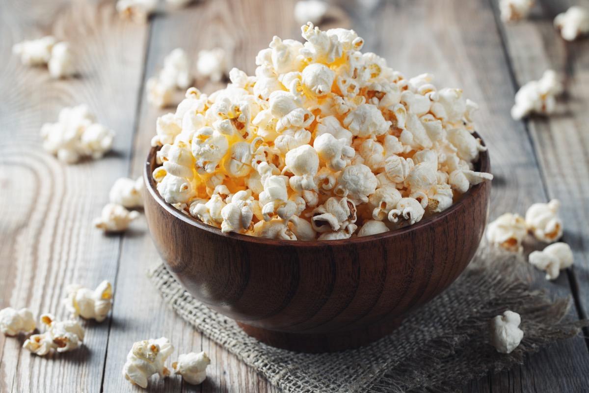 wooden bowl full of popcorn