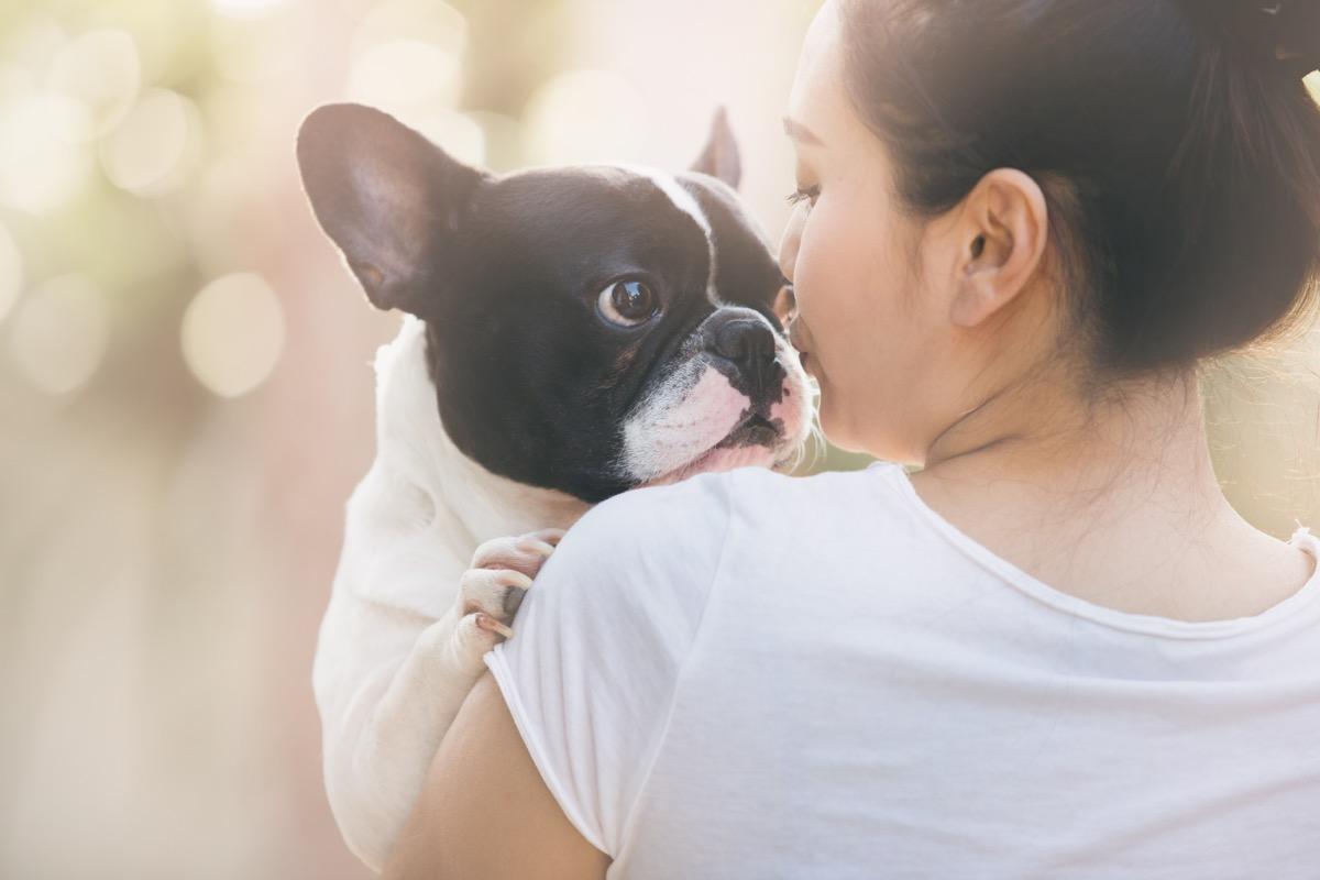 Woman holding little dog