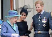 Queen Elizabeth, Meghan Markle and Prince Harry at Buckingham Palace Balcony to commemorate 100 years of the RAF in 2018