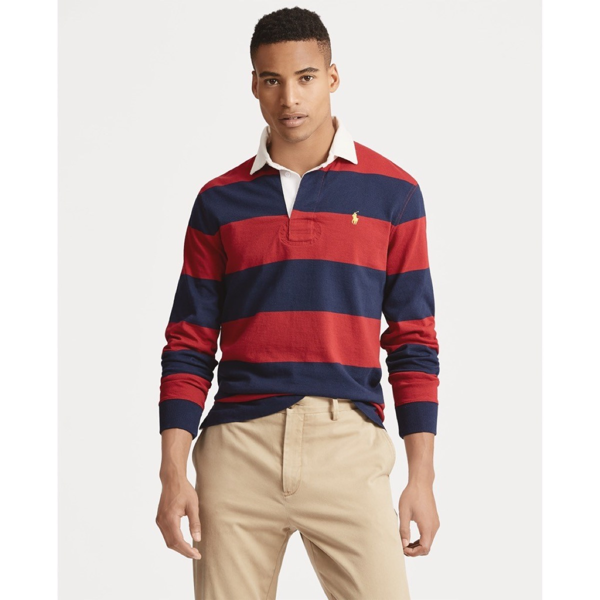 young man wearing red and blue striped rugby shirt