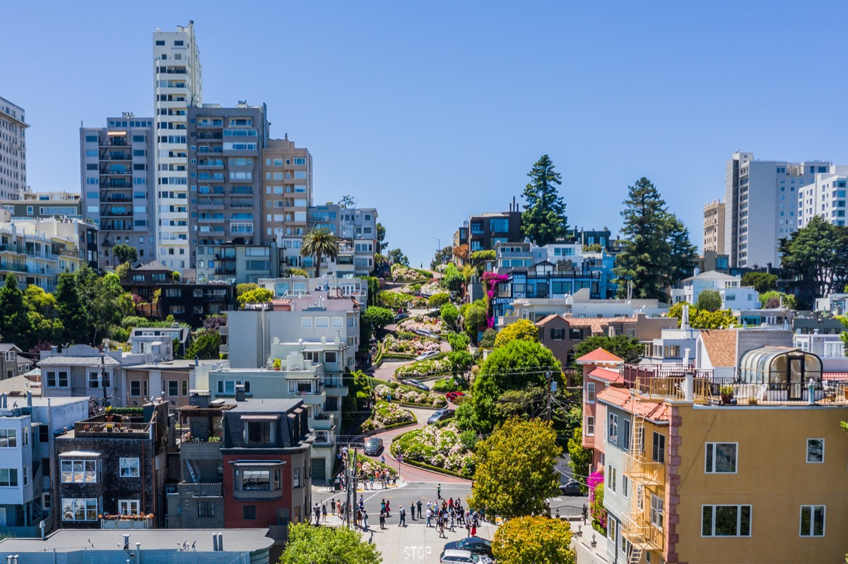"""An aerial view of the famous """"crooked"""" street in San Francisco, Lombard Street. A bright sunny day with a clear view."""